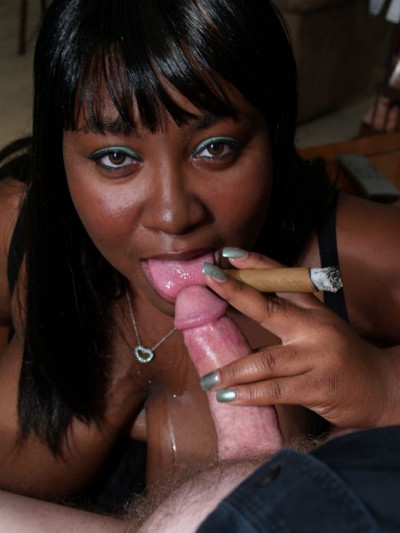 Timeka Taylor puffing on a cigar and a dick
