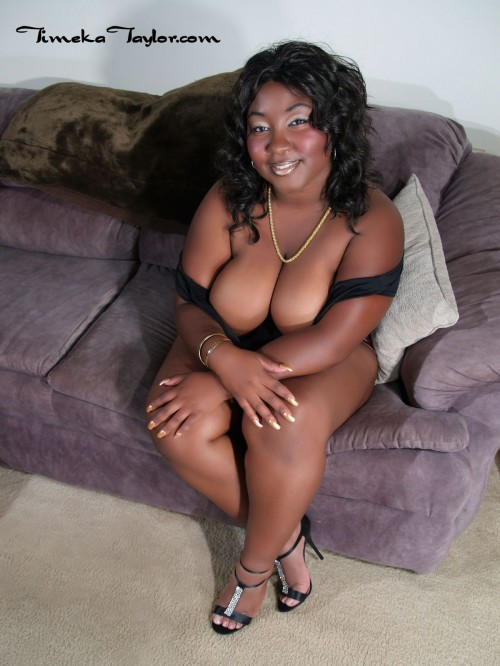 Black bbw, Timeka, shows off her big black tits in high heels.