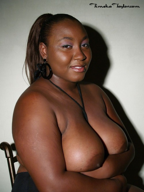 Ebony coed exposes her big tits and large areolas in a glamour photo shoot.
